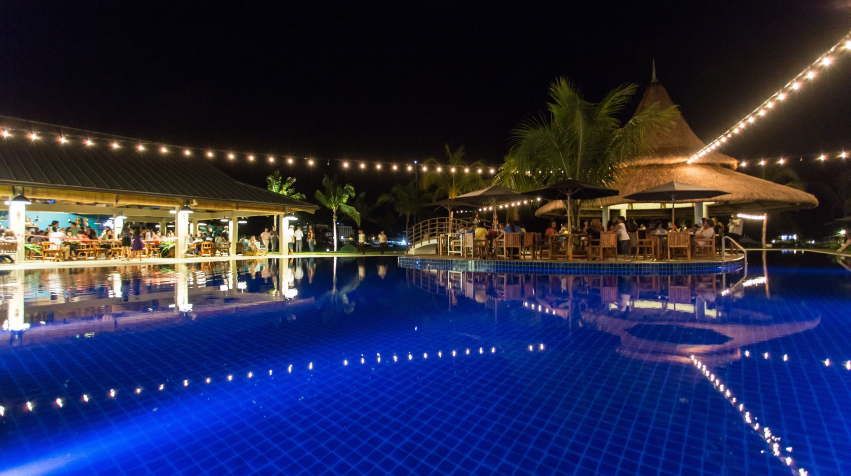beautiful night pool at cove resort palau